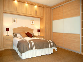 Sliding Doors in Light Wood - matching Cupboards